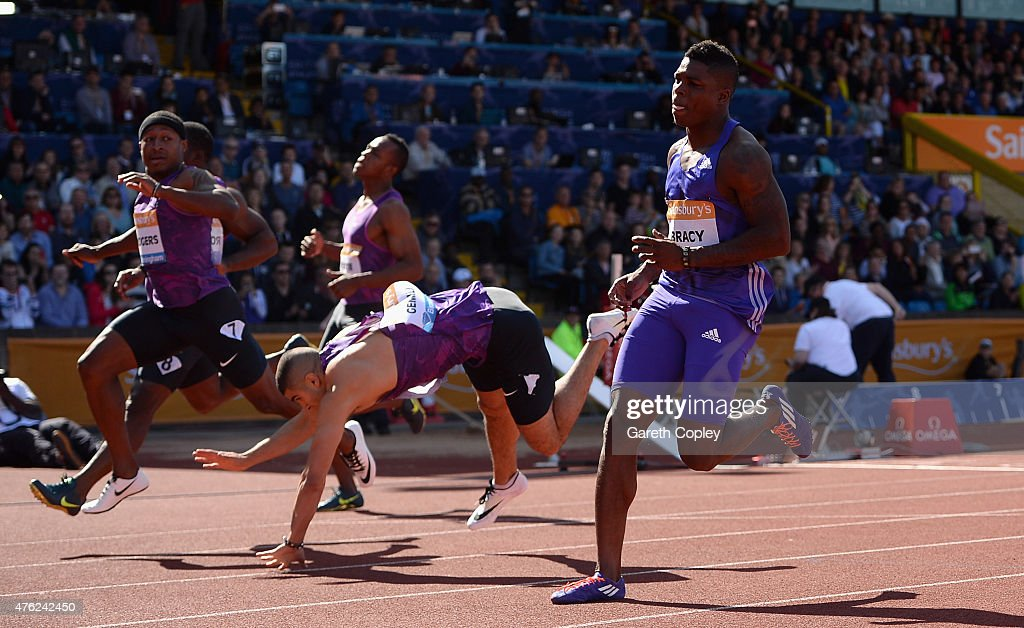 Marvin Bracy of USA wins the Mens 100 metres as Adam Gemili of Great Britain pulls up with injury during the Sainsbury's Birmingham Grand Prix at...