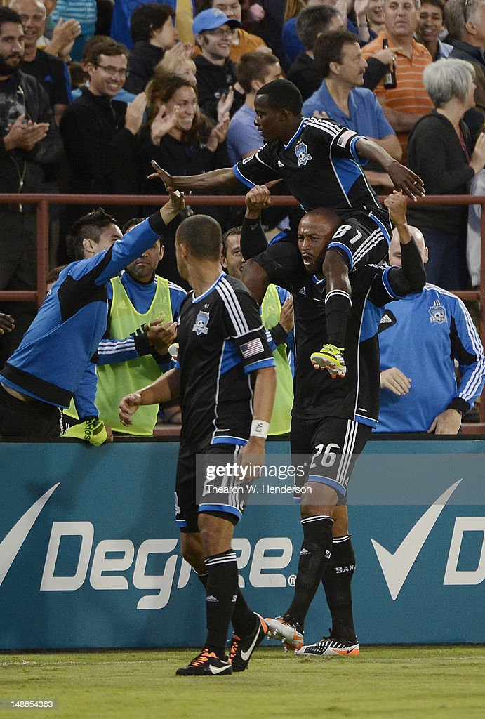 Marvin Chavez #81, Jason Hernandez #21 and Victor Bernardez #26 of the San Jose Earthquakes celebrate after Chavez scored a goal in the first half against FC Dallas during an MLS Soccer game at Buck Shaw Stadium on July 18, 2012 in Santa Clara, California.