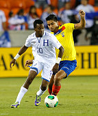 Marvin Chavez of Honduras against Christian Noboa of Ecuador during an international friendly match at BBVA Compass Stadium on November 19 2013 in...