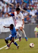 Marvin Chavez of Honduras battles for the ball against Juan Diego Madrigal of Costa Rica during the 2013 CONCACAF Gold Cup quarterfinal game at MT...
