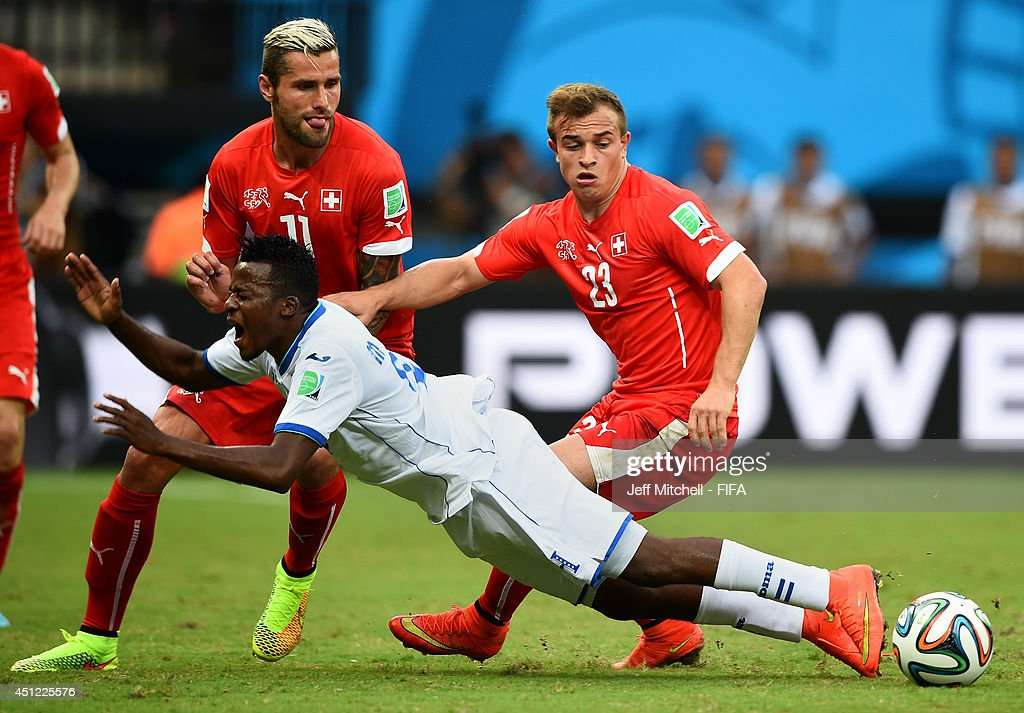 Marvin Chavez of Honduras is brought down by <a gi-track='captionPersonalityLinkClicked' href=/galleries/search?phrase=Xherdan+Shaqiri&family=editorial&specificpeople=6923918 ng-click='$event.stopPropagation()'>Xherdan Shaqiri</a> of Switzerland during the 2014 FIFA World Cup Brazil Group E match between Honduras and Switzerland at Arena Amazonia on June 25, 2014 in Manaus, Brazil.