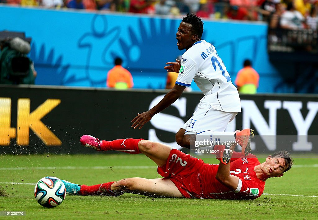Marvin Chavez of Honduras is tackled by Stephan Lichtsteiner of Switzerland during the 2014 FIFA World Cup Brazil Group E match between Honduras and Switzerland at Arena Amazonia on June 25, 2014 in Manaus, Brazil.