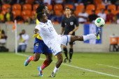 Marvin Chavez of Honduras jumps for the ball against Juan Carlos Paredes of Ecuador during an international friendly match at BBVA Compass Stadium on...