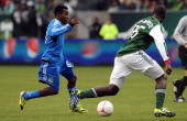 Marvin Chavez of San Jose Earthquakes dribbles the ball as Andrew JeanBaptiste of Portland Timbers defends during the first half of the game at...