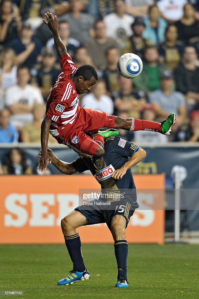 Marvin Chavez #18 of the FC Dallas goes over the top of Gabriel Farfan #15 of the Philadelphia Union at PPL Park on August 13, 2011 in Chester, Pennsylvania.