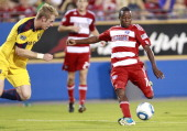 Marvin Chavez of the FC Dallas passes the ball during the away from Nat Borchers of the Real Salt Lake and Ned Grabavoy during the 2011 US Open Cup...