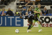 Marvin Chavez of the San Jose Earthquakes chasing after the ball is tripped up by Jeff Parke of the Seattle Sounders during the second half of a MLS...