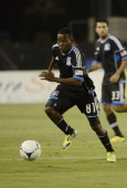 Marvin Chavez of the San Jose Earthquakes dribbles the ball up field against the Seattle Sounders during an MLS Soccer game at Buck Shaw Stadium on...