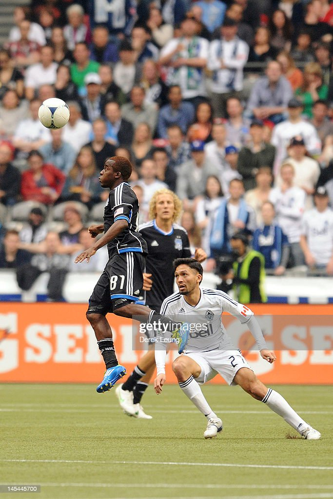Marvin Chavez #81 of the San Jose Earthquakes hits a header in front Jun Marques Davidson #27 of the Vancouver Whitecaps during the MLS match at BC Place on May 5, 2012 in Vancouver, British Columbia, Canada. Vancouver won 2-1.