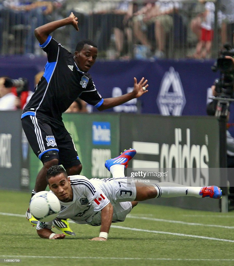 <a gi-track='captionPersonalityLinkClicked' href=/galleries/search?phrase=Marvin+Chavez&family=editorial&specificpeople=5546152 ng-click='$event.stopPropagation()'>Marvin Chavez</a> #81 of the San Jose Earthquakes reacts after tripping Camilo #37 of the Vancouver Whitecaps FC to the turf during their MLS game July 22, 2012 at BC Place in Vancouver, British Columbia, Canada.