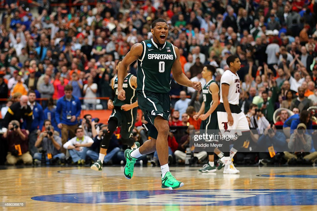 Marvin Clark Jr #0 of the Michigan State Spartans celebrates defeating the Louisville Cardinals 76 to 70 in overtime of the East Regional Final of...