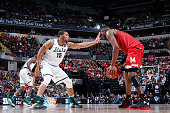 Marvin Clark Jr #15 of the Michigan State Spartans defends against Robert Carter of the Maryland Terrapins in the semifinals of the Big Ten...