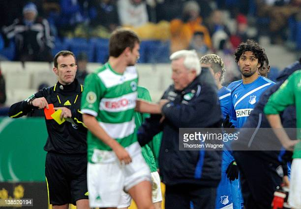 Marvin Comper of Hoffenheim is shown the red card by referee Marco Fritz after a foul against Christopher Noethe of Fuerth during the DFB Cup Quarter...