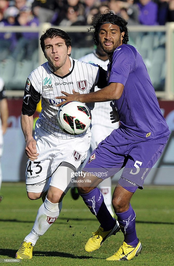 <a gi-track='captionPersonalityLinkClicked' href=/galleries/search?phrase=Marvin+Compper&family=editorial&specificpeople=739239 ng-click='$event.stopPropagation()'>Marvin Compper</a> of ACF Fiorentina #5 and <a gi-track='captionPersonalityLinkClicked' href=/galleries/search?phrase=Alberto+Paloschi&family=editorial&specificpeople=3817495 ng-click='$event.stopPropagation()'>Alberto Paloschi</a> of AC Chievo Verona compete for the ball during the Serie A match between ACF Fiorentina and AC Chievo Verona at Stadio Artemio Franchi on March 3, 2013 in Florence, Italy.