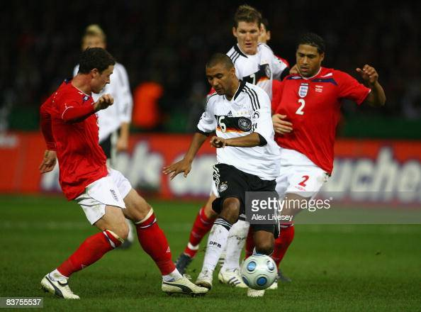 Marvin Compper of Germany is challenged by Wayne Bridge of England during the International Friendly match between Germany and England at the Olympic...