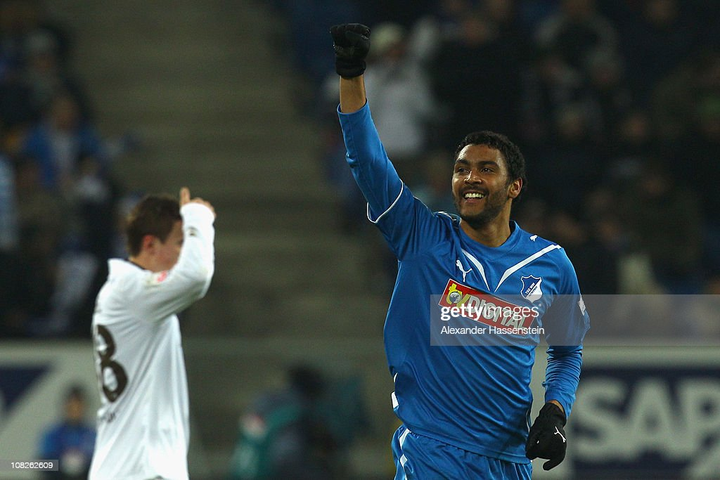<a gi-track='captionPersonalityLinkClicked' href=/galleries/search?phrase=Marvin+Compper&family=editorial&specificpeople=739239 ng-click='$event.stopPropagation()'>Marvin Compper</a> (R) of Hoffenheim celebrates scoring the first team goal whilst <a gi-track='captionPersonalityLinkClicked' href=/galleries/search?phrase=Max+Kruse&family=editorial&specificpeople=3945507 ng-click='$event.stopPropagation()'>Max Kruse</a> (L) of St. Pauli looks dejected during the Bundesliga match between 1899 Hoffenheim and FC St. Pauli at Rhein-Neckar Arena on January 23, 2011 in Sinsheim, Germany.
