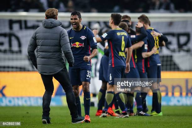 Marvin Compper of Leipzig and head coach Ralph Hasenhuettl celebrate after the the Bundesliga match between Borussia Moenchengladbach and RB Leipzig...