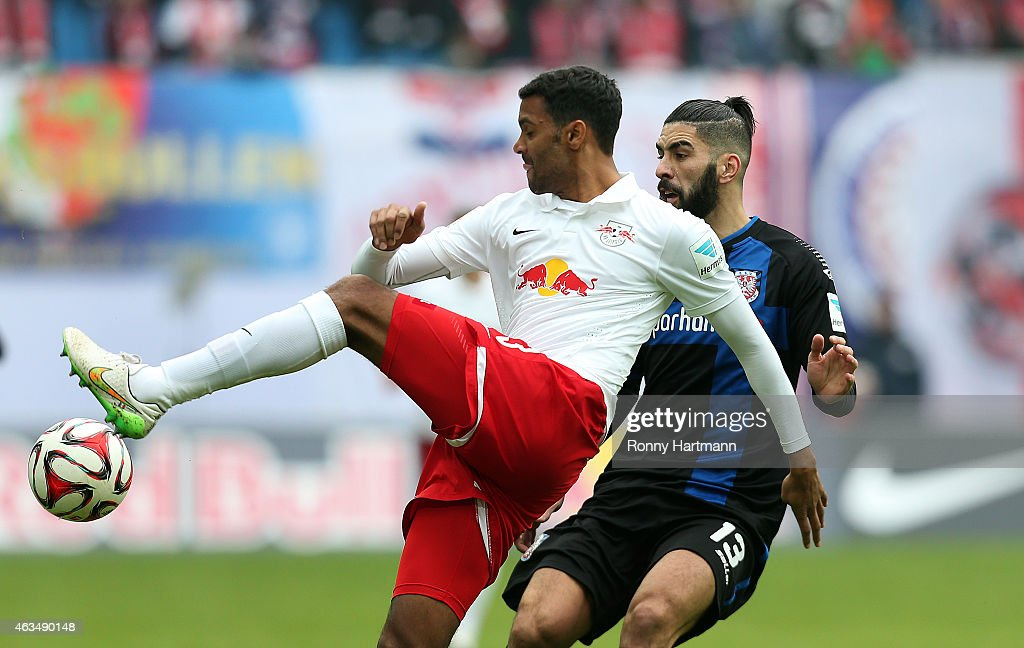 Marvin Compper (L) of Leipzig and Mohamed Amine Aoudia of Frankfurt vie for the ball during the Second Bundesliga match between RB Leipzig and FSV Frankfurt at Red Bull Arena on February 15, 2015 in Leipzig, Germany.