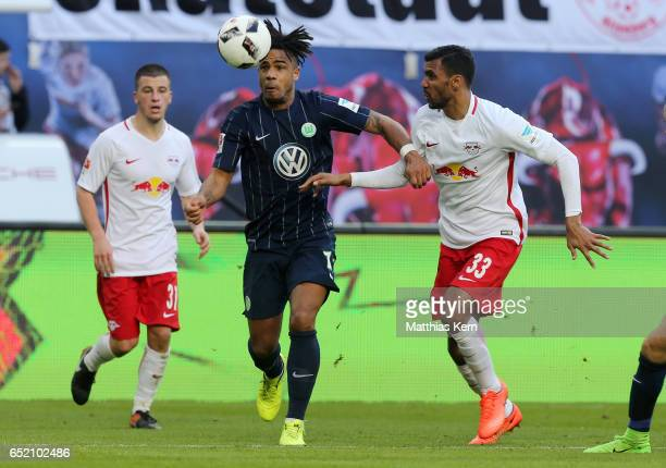 Marvin Compper of Leipzig battles for the ball with Daniel Didavi of Wolfsburg during the Bundesliga match between RB Leipzig and VfL Wolfsburg at...