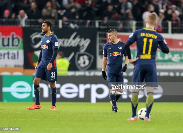 Marvin Compper of Leipzig Diego Demme of Leipzig Timo Werner of Leipzig looks dejected during the Bundesliga match between FC Augsburg and RB Leipzig...