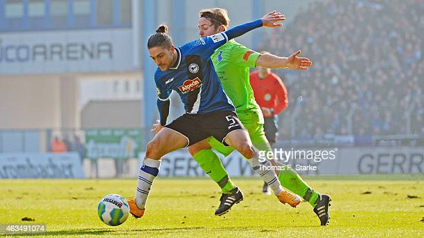 Marvin Dausch of Duisburg tackles David Ulm of Bielefeld during the Third League match between Arminia Bielefeld and MSV Duisburg at Schueco Arena on...