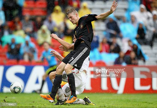 Marvin Ducksch of Germany tackles Zachary Carroll of USA during the FIFA U17 World Cup round of 16 match between Germany and the USA at the...