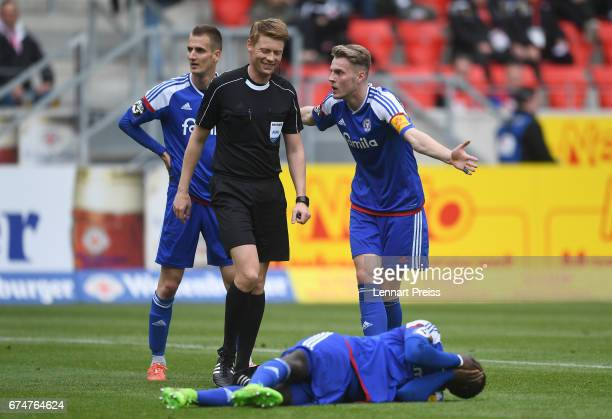 Marvin Ducksch of Holstein Kiel argues with referee Christian Dingert during the 3 Liga match between Jahn Regensburg and Holstein Kiel on April 29...