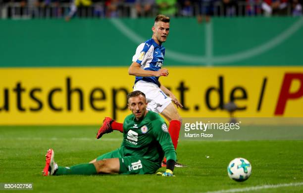 Marvin Duksch of Kiel scores the 2nd goal during the DFB Cup first round match between Holstein Kiel and Eintracht Braunschweig at HolsteinStadion on...