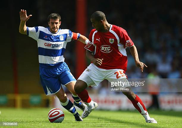 Marvin Elliott of Bristol battles with Adam Boulder of QPR during the CocaCola Championship match between Bristol City and Queens Park Rangers at...
