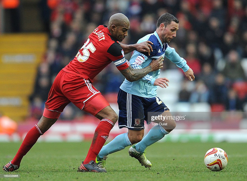Marvin Elliott of Bristol City and Scott McDonald of Middlesbrough battle for the ball during the npower Championship match between Bristol City and...