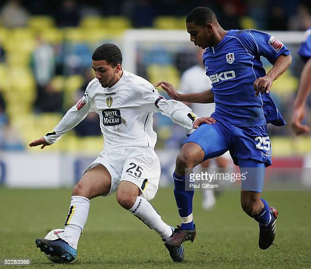 Marvin Elliott of Millwall battles for the ball with Aaron Lennon of Leeds United during the CocaCola Championship match between Millwall and Leeds...
