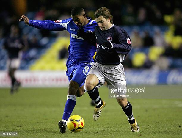 Marvin Elliott of Millwall battles with Bobby Convey of Reading during the CocaCola Championship match between Millwall and Reading at The New Den on...