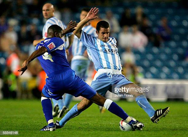 Marvin Elliott of Millwall battles with Michael Doyle of Coventry City during the CocaCola Championship match between Millwall and Coventry City at...