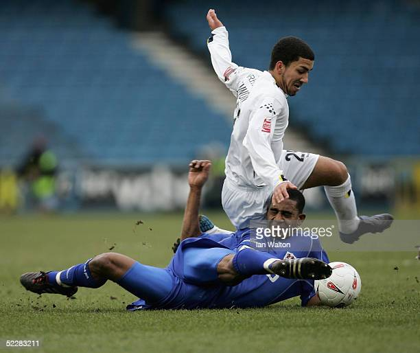 Marvin Elliott of Millwall tries to tackle AAron Lennon of Leeds during the CocaCola Championship match between Millwall and leeds united at the New...