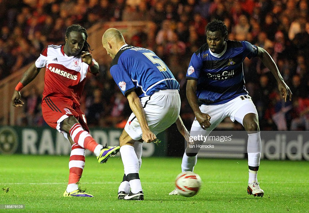 Marvin Emners of Middlesbrough shoots as Doncaster's Rob Jones (C) and <a gi-track='captionPersonalityLinkClicked' href=/galleries/search?phrase=Bongani+Khumalo&family=editorial&specificpeople=4501463 ng-click='$event.stopPropagation()'>Bongani Khumalo</a> defend during the Sky Bet Championship game between Middlesbrough and Doncaster Rovers at the Riverside Stadium on October 25, 2013 in Middlesbrough, England.