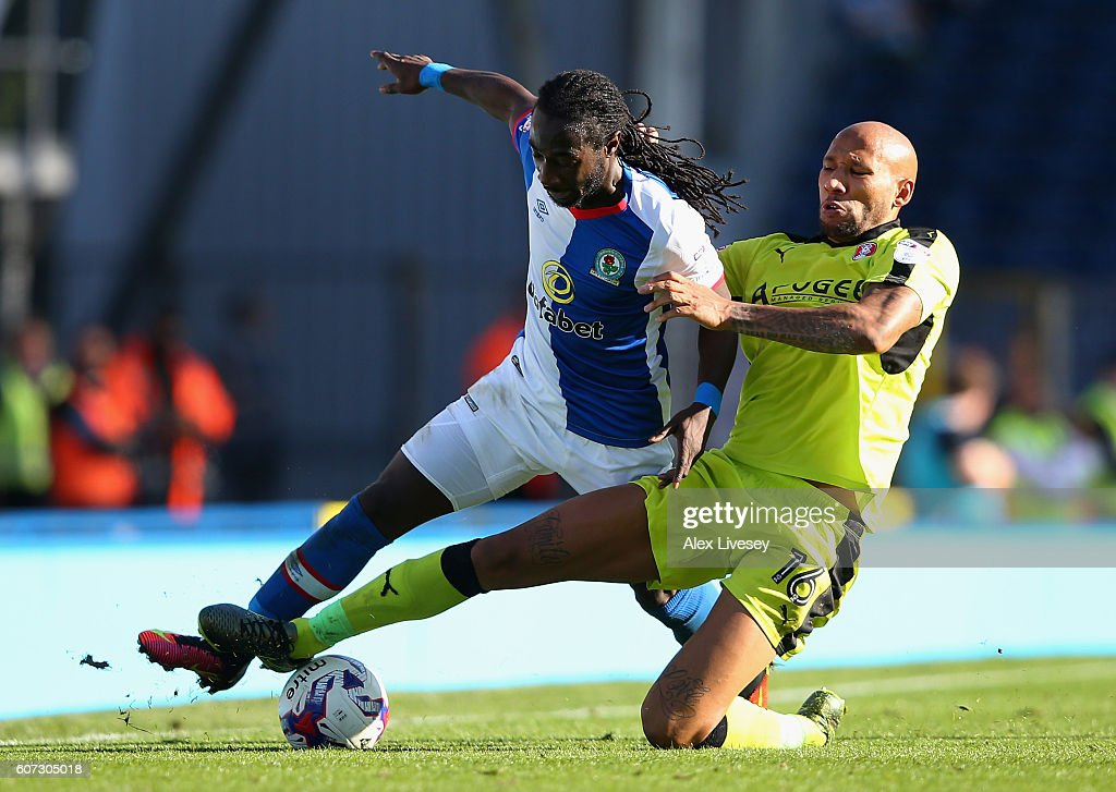 Marvin Emnes of Blackburn Rovers is tackled by Kelvin Wilson of Rotherham United during the Sky Bet Championship match between Blackburn Rovers and Rotherham United at Ewood Park on September 17, 2016 in Blackburn, England.