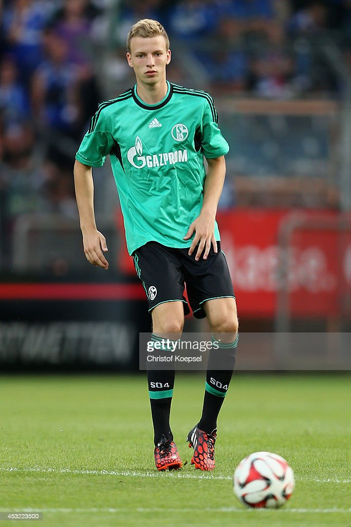 Marvin Friedrich of Schalke runs with the ball during the pre-season friendly match between VfL Bochum and FC Schalke 04 at Rewirpower Stadium on August 5, 2014 in Bochum, Germany.