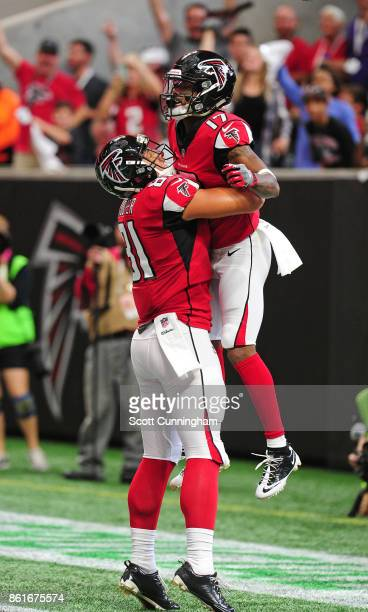 Marvin Hall of the Atlanta Falcons is congratulated by Austin Hooper after scoring a touchdown against the Miami Dolphins at MercedesBenz Stadium on...