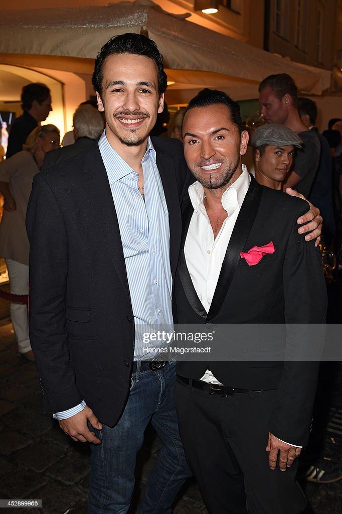 Marvin Herzsprung and Marcus Heinzelmann attend the Marcus Heinzelmann Boutique Opening on July 29, 2014 in Munich, Germany.
