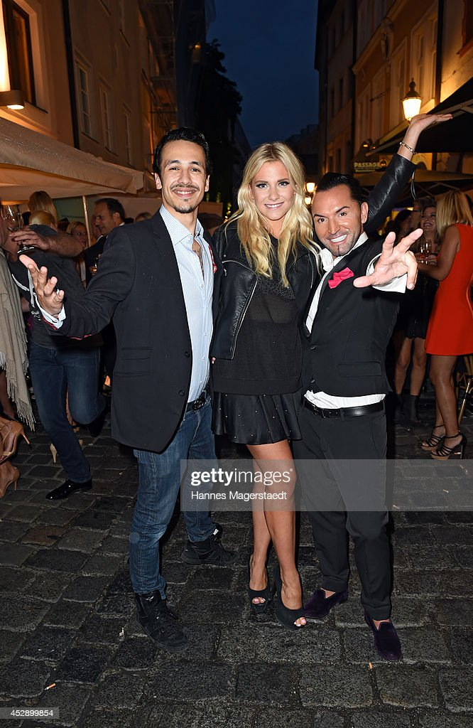 Marvin Herzsprung, Valentina Pahde and Marcus Heinzelmann attend the Marcus Heinzelmann Boutique Opening on July 29, 2014 in Munich, Germany.