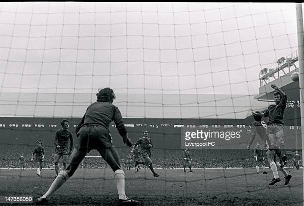 Marvin Hinton of Chelsea goes up for the header with Bobby Graham of Liverpool as Peter Bonetti stands guard in goal during the Football League...