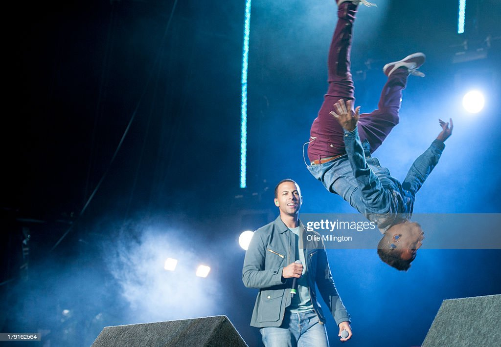 Marvin Humes and Aston Merrygold of JLS perform on stage on Day 1 of Fusion Festival 2013 at Cofton Park on August 31, 2013 in Birmingham, England.