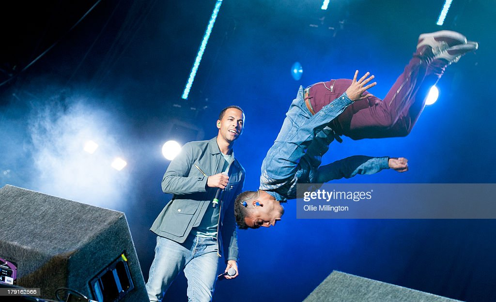 Marvin Humes and <a gi-track='captionPersonalityLinkClicked' href=/galleries/search?phrase=Aston+Merrygold&family=editorial&specificpeople=5739699 ng-click='$event.stopPropagation()'>Aston Merrygold</a> of JLS perform on stage on Day 1 of Fusion Festival 2013 at Cofton Park on August 31, 2013 in Birmingham, England.
