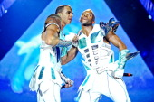 Marvin Humes and Oritse Williams of JLS perform on stage in aid of Sport Relief at O2 Arena on March 24 2012 in London United Kingdom