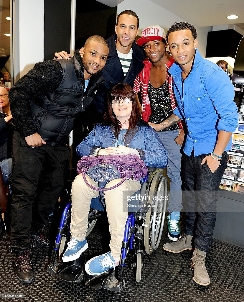 JB, Marvin Humes, Oritse Williams and Aston Merrygold of JLS meet fans and sign copies of their new album 'Jukebox' at HMV on November 16, 2011 in Manchester, England.