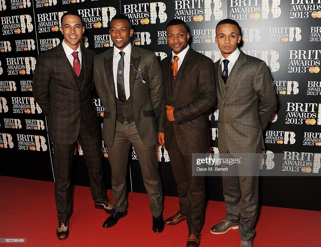 Marvin Humes, Oritse Williams, Jonathan 'JB' Gill and Aston Merrygold of JLS arrive at the BRIT Awards 2013 at the O2 Arena on February 20, 2013 in London, England.