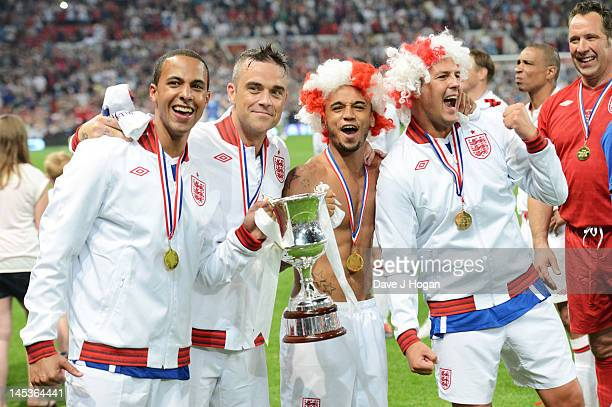 Marvin Humes Robbie Williams Aston Merrygold and Paddy McGuinness attend Soccer Aid 2012 in aid of Unicef at Old Trafford on May 27 2012 in...