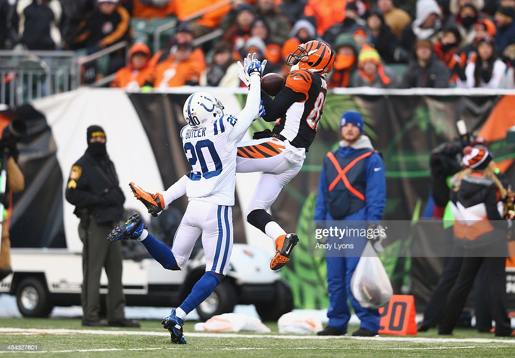 Marvin Jones #82 of the Cincinnati Bengals catches a pass while defended by <a gi-track='captionPersonalityLinkClicked' href=/galleries/search?phrase=Darius+Butler&family=editorial&specificpeople=3967703 ng-click='$event.stopPropagation()'>Darius Butler</a>#20 of the Indianapolis Colts during the NFL game at Paul Brown Stadium on December 8, 2013 in Cincinnati, Ohio.