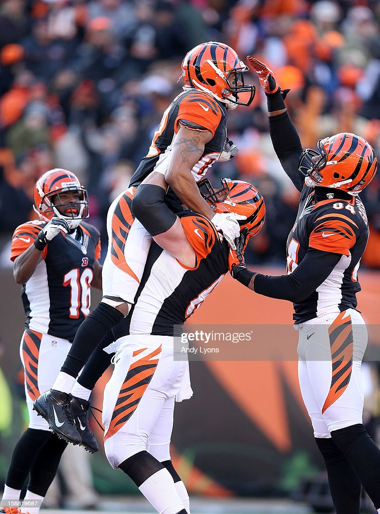 Marvin Jones #82 of the Cincinnati Bengals celebrates after scoring a touchdown during the NFL game against the Baltimore Ravens at Paul Brown Stadium on December 30, 2012 in Cincinnati, Ohio.