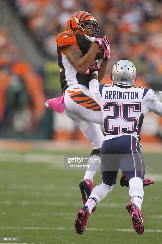 Marvin Jones #82 of the Cincinnati Bengals hauls in the pass in front of <a gi-track='captionPersonalityLinkClicked' href=/galleries/search?phrase=Kyle+Arrington&family=editorial&specificpeople=5443555 ng-click='$event.stopPropagation()'>Kyle Arrington</a> #25 of the New England Patriots during their game at Paul Brown Stadium on October 6, 2013 in Cincinnati, Ohio. The Bengals defeated the Patriots 13-6.